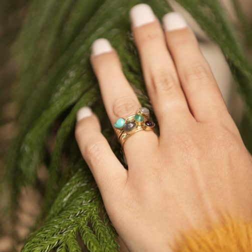 Brass, bohemian-style ring with varying attached bands and 5 natural stones.