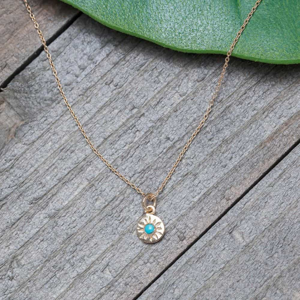 tiny compass necklace with turquoise