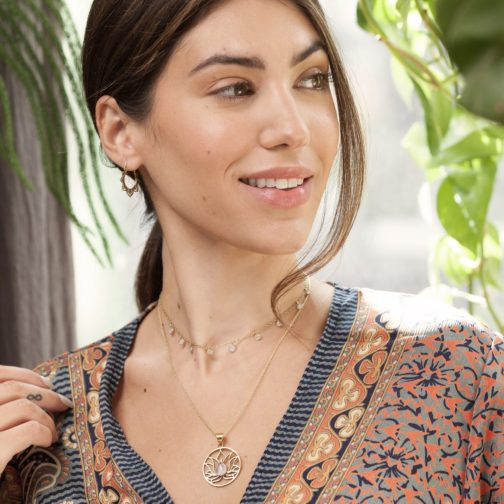 smiling woman wearing a fair trade moonstone droplet necklace from Baizaar Jewelry.