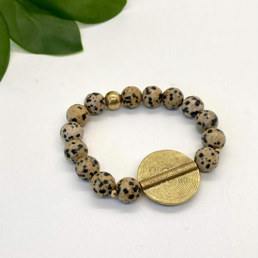 Natural Dalmatian Jasper stone elastic bracelet with etched circle accent bead.