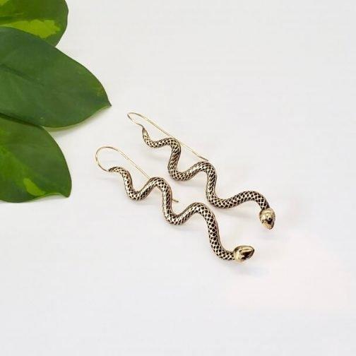 Brass serpent earrings from Baizaar Jewelry.