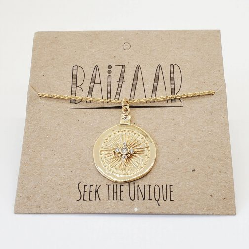 Crystal medallion necklace in polished brass by Baizaar Jewelry.
