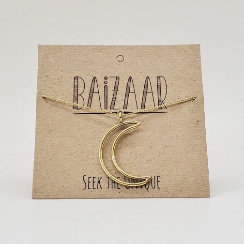Cutout Crescent Necklace in brass.